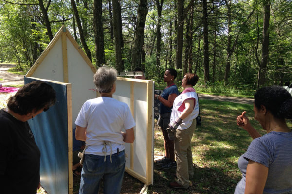 Ife Franklin and her crew installing the Slave Cabin in Franklin Park. It remained in the park for several weeks along with other art installations.